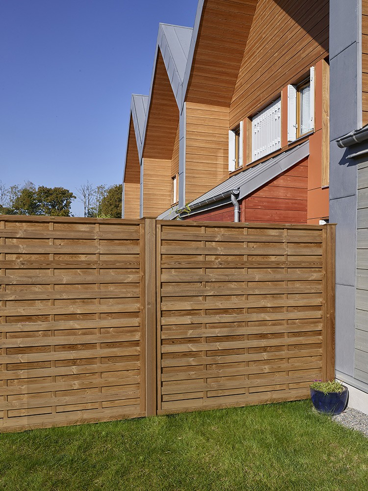 Palissade en bois Aquilon Pin classe 4 technologie DURAPIN marque PIVETEAUBOIS marron par imprégnation Vivre en Bois