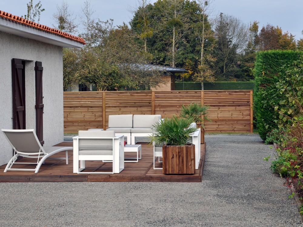 Clôture bois avec panneaux empilables Olympe persiennés Pin classe d'emploi 4 technologie DURAPIN marque PIVETEAUBOIS Vivre en Bois